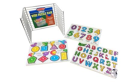 Melissa & Doug's Top 3 Peg Puzzles and Metal Storage Rack 16f4bb3c-6b15-4900-9f88-36801ae0127e