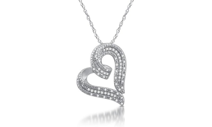 Up to 84 off on 12 cttw diamond heart shaped groupon goods 12 cttw diamond heart shaped pendant in sterling silver by decarat aloadofball Gallery