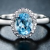 Genuine Sky Blue Topaz and Diamond Accent Halo Ring By GEMBASSY