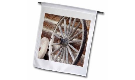 Garden Flag Canada, Fort Steele. Wagon wheel, grinding stone, and log cabin.
