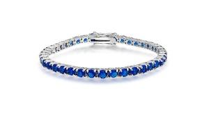 Round Cut Sapphire Tennis Bracelet in 18K White Gold