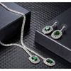 Halo emerald necklace & earring set