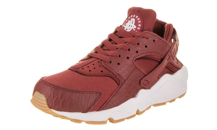 3addc0fb10a1 Nike Women s Air Huarache Run SE Running Shoe Medium 6 Women US Cedar Cedar  Gum Yellow White Running textile