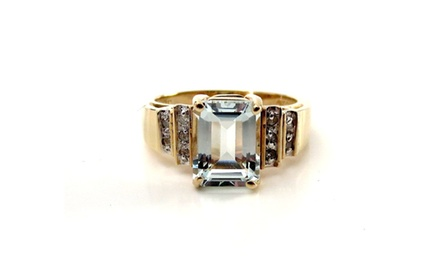 1.60ct Aquamarine Emerald Cut with 0.10ct Rd Diamonds Set On 14K Yellow Gold Ring.