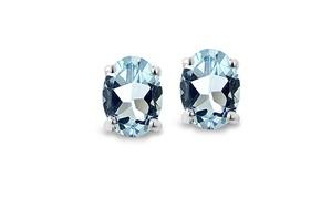 Sterling Silver 1 Ct Blue Topaz 6x4 Oval Stud Earrings