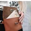 HipZii cellphone purse made of PU leather.